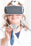 Physician using virtual reality headset Stock Image