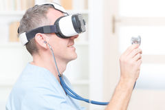 Physician using virtual reality headset Stock Images