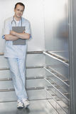 Physician Waiting In Elevator Stock Photos