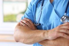Physician wearing blue uniform Royalty Free Stock Photos