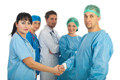 Physician woman and surgeon man handshake Royalty Free Stock Images