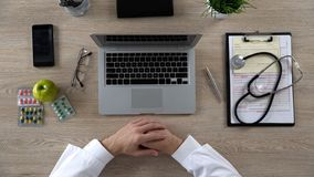 Physician at working place in clinic, doctors hands on table top view, research. Stock photo royalty free stock photos