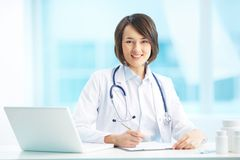 Physician at workplace Stock Photo