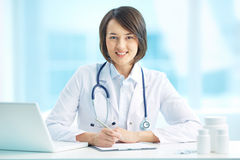 Physician at workplace Stock Photos