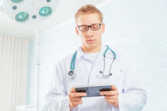 Physician works on a tablet computer Stock Photo