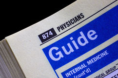 Physicians. Searching directory pages for a qualified physician Royalty Free Stock Photography