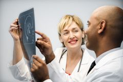Physicians analyzing xray. Stock Photos