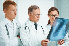 Physicians examine x-ray image of lungs Royalty Free Stock Images