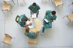 Physicians In Meeting At Cafeteria Royalty Free Stock Photo