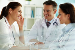 Physicians and patient stock images