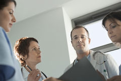 Physicians Reviewing Medical Chart Royalty Free Stock Photo