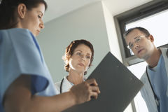Physicians Reviewing Medical Chart Stock Image