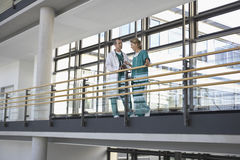 Physicians Talking On Balcony Stock Photo