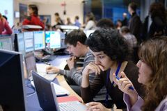 Physicists in the experiment control room Stock Photo