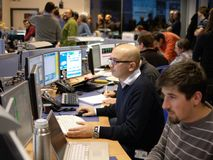 Physicists in the experiment control room Stock Photography