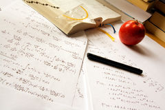 Physics. A desk with physics calculations, books, an open book, a pencil and a set square royalty free stock photography