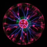 Physics. Purple plasma lightnings drawing from center to margin of sphere Stock Images