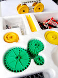 Physics assembling toy kit. A science experiment assembly kit, brightly coloured.  With many small components packed neatly in box.  Kit contains many small Royalty Free Stock Photo