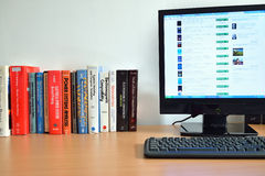 Physics books near desktop computer Stock Photography