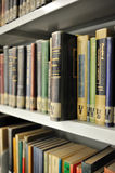 Physics library. Different physics books on the shelves inside college library Royalty Free Stock Images