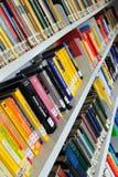 Physics books on shelves Stock Photo