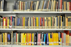 Physics books on shelves in library Stock Photos
