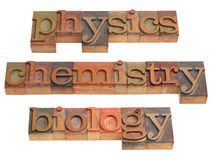 Physics, chemistry and biology. Natural science concept - words in vintage wooden letterpress printing blocks isolated on white Stock Photos