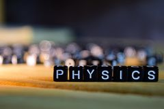 PHYSICS concept wooden blocks on the table. stock photo