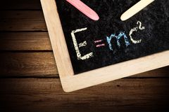 Physics. Einstein concept billboard wisdom chalkboard mathematics Royalty Free Stock Photos