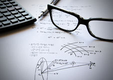 Physics exercises and school. Physics exercises written on a white paper. School time Stock Photos