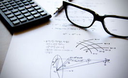 Physics exercises written on a white paper Stock Photos