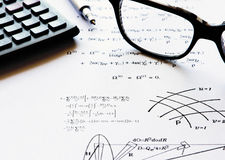 Physics exercises written on a white paper royalty free stock image