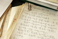 Physics formulas. And calculations written on paper, quantum hydrodynamics of a single particle Stock Photography