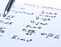 Physics formulas written on a white paper royalty free stock photos