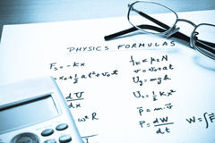 Physics formulas written on a white paper Royalty Free Stock Image