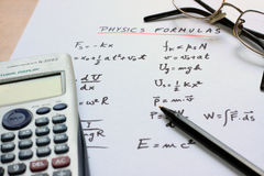 Physics formulas written on a white paper royalty free stock images