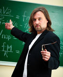 Physics professor. In the classroom royalty free stock image