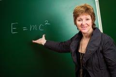 Physics professor. Against blackboard background stock photography