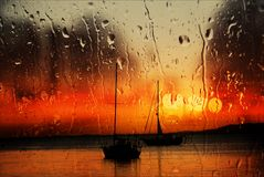 Sunset Boats in the Rain Royalty Free Stock Photos