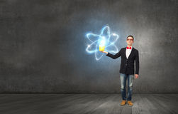 Physics science concept. Young man in black jacket with yellow bucket in hand Stock Photography