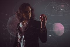 Physics the science of nature, the concept of studying the laws of nature. A young man in the image of Isaac Newton. With an Apple in hand, the concept of the royalty free stock photos