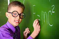 Physics. Smart schoolboy stands at the blackboard in the classroom. Education Stock Image