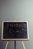 Physics word and formula E=mc2 on chalkboard Stock Image