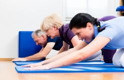 Physio doing kinesitherapy with senior patients Stock Photo