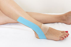 Physio tape on leg. A tape on a female leg Stock Image