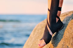 Physio tape. Therapeutic treatment of leg with black physio tape Royalty Free Stock Image