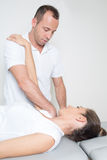 Physio-therapeutic arm stretching Stock Photos