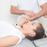 Physio-therapeutic arm stretching Stock Photo