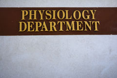 Physiology Department. Embossed Physiology department old signboard royalty free stock photography
