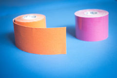 Physiotape physiotherapy color tape bandage rolls. Physiotape physiotherapy color tape bandage kinesiotape rolls for kinesiotaping taping treatment in real life stock images